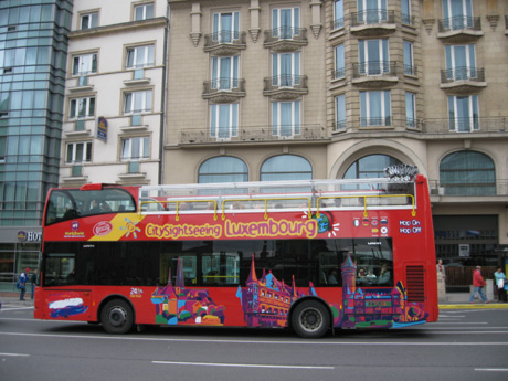 City sight seeing luxembourg red bus photo