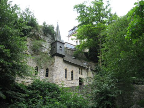 Small castle surrounded by green vegetation luxembourg grund photo